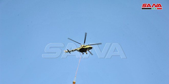Lazkiye Kırsalındaki Cebel El Şecre Ormanlarında Çıkan Yangını Söndürme Çabaları Ordu Helikopterlerinin Katılımıyla Devam Ediliyor (VİDEO)